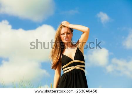 Little shocked woman on beach. Long hair girl model blue sky. - stock photo