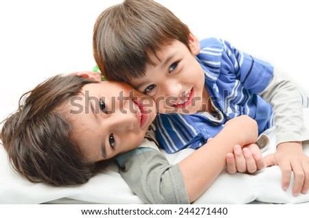 Little sibling boy playing together - stock photo