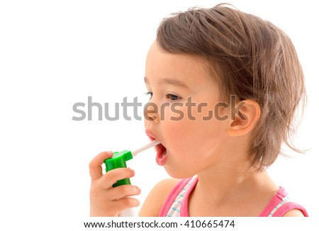 Little sick girl used medical spray for breath - stock photo