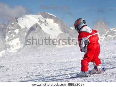 Little skier on a ski slope, Dolomite Mountains.