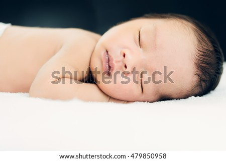 little sleeping sweet bare newborn.with selective/soft focus.