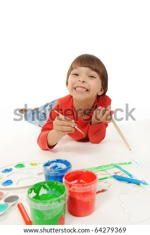 little smiling boy draws paint. Isolated on white background - stock photo