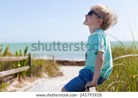 little smiling boy enjoying his summer vacation - stock photo