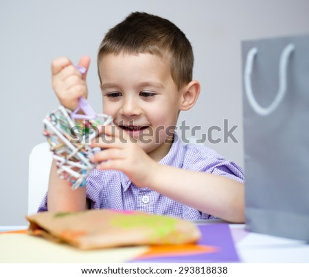 Little smiling Boy holding present box