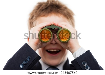 Little smiling child boy in business suit hand holding binoculars lens looking for direction white isolated - stock photo