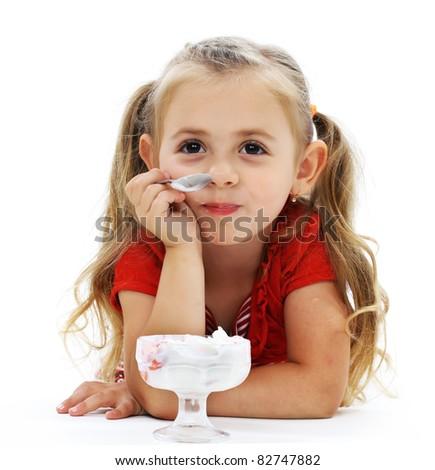 Little smiling girl eating ice cream - stock photo