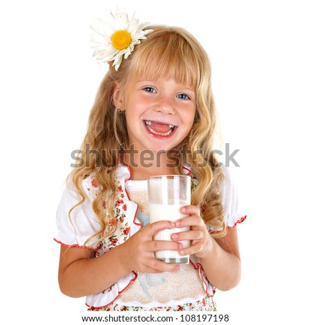 Little smiling girl holding a glass of milk isolated on white background - stock photo