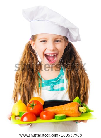 little smiling girl with a board of vegetables and fruits on white background - stock photo