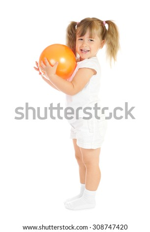 Little smiling girl with ball isolated - stock photo