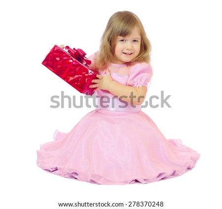 Little smiling girl with gift box isolated - stock photo