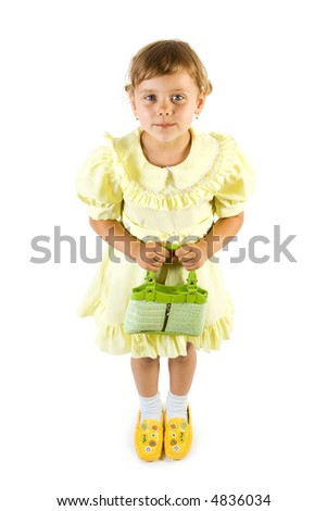 Little smiling girl with green bag. Isolate on white background.