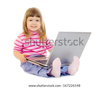 Little smiling girl with laptop isolated