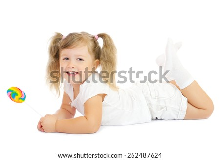 Little smiling girl with lollipop isolated - stock photo