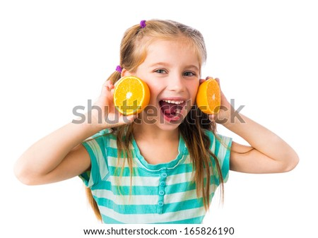 little smiling girl with two halves of oranges isolated on white background