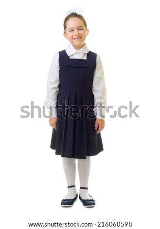Little smiling schoolgirl isolated on white