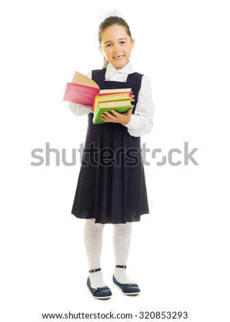 Little smiling schoolgirl with books isolated