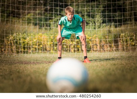 little soccer goalkeeper in goal