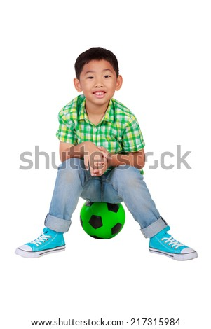 little soccer player boy with ball having fun isolated on white background - stock photo