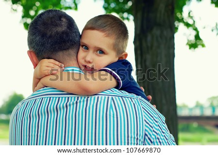 little son adores father - stock photo