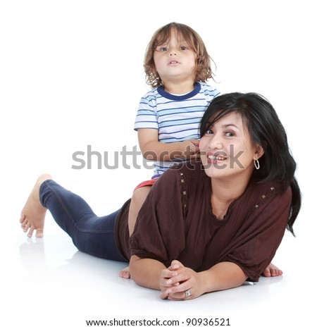 little son and his pretty young mother isolated over white background - stock photo