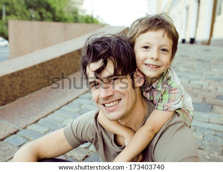 little son with father in city hagging and smiling - stock photo