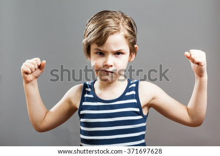 Little Sportive Tough Boy in striped  muscle shirt, showing his muscles