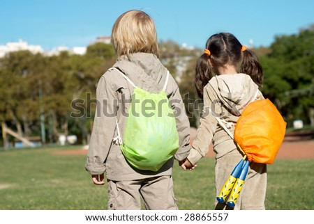 Little sports pair in park
