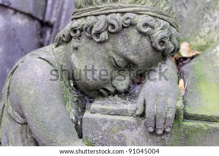 Little stone Kid on the old Prague Cemetery - stock photo