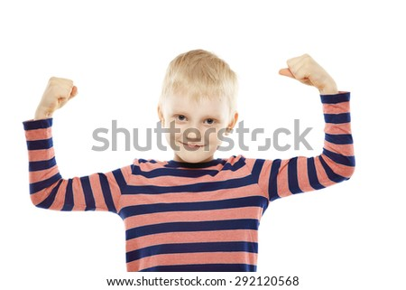Little strong boy playing with muscles and smiling. Isolated on white background