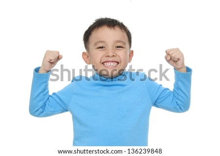 Little strong boy showing his muscles isolated