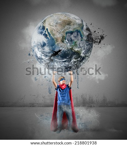 Little superhero saves the world. Earth provided by NASA - stock photo