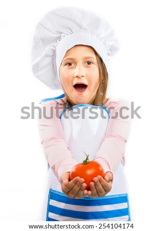 Little surprised chef holding a tomato isolated on white background - stock photo