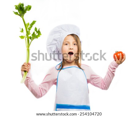 Little surprised chef holding vegetables isolated on white background  - stock photo