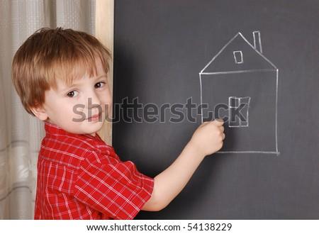 Little sweet artist chalk his home. - stock photo