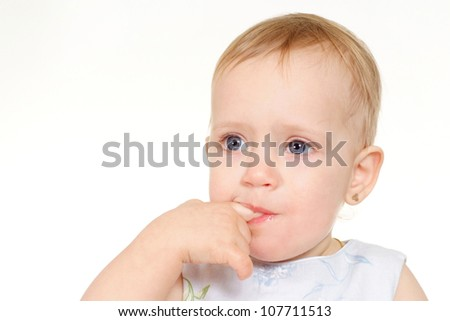 Little sweet  kid in a dress on a white background