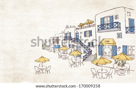 Little tables outside of a restaurant building. - stock photo