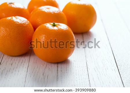 little tangerines on white wood table