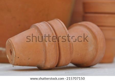 little terracotta pots on outdoor table - stock photo