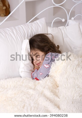 Little Tired baby goes to sleep in light pleasant room under warm blanket