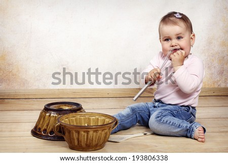 Little toddler cooking - stock photo