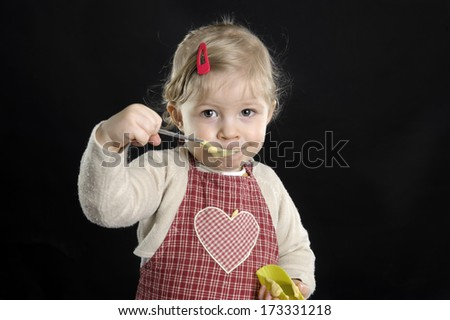 little toddler cooking in the kitchen - stock photo