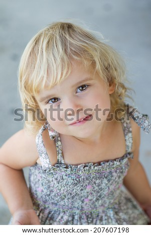 Little toddler girl in beautiful dress - stock photo