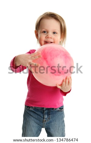 Little toddler girl playing with a pink toy ball - stock photo