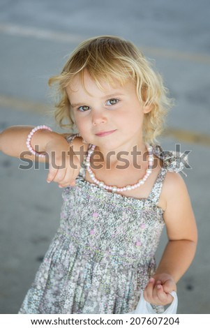 Little toddler girl showing off her jewelry - stock photo