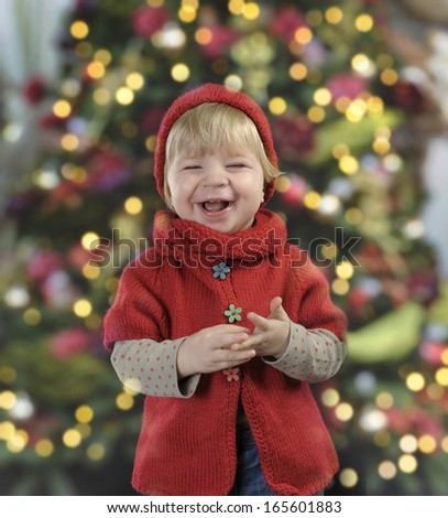 little toddler in front of a christmas tree