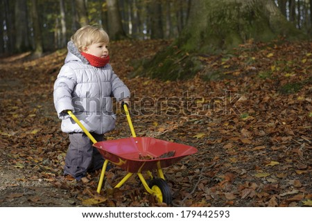 little toddler outdoors in the forest