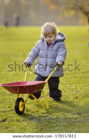 little toddler playing outdoors