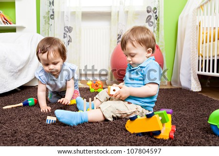 little toddler twins playing in the child's room