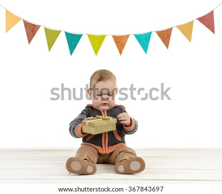 little toddler with gift