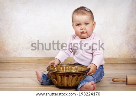 Little toddler with marble form and rolling pin - stock photo